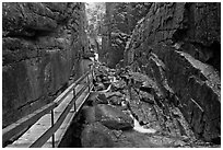 Hiking the Flume in the rain, Franconia Notch State Park. New Hampshire, USA (black and white)
