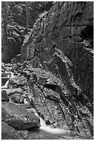 Flume brook at the base of granite and basalt walls, Franconia Notch State Park. New Hampshire, USA (black and white)