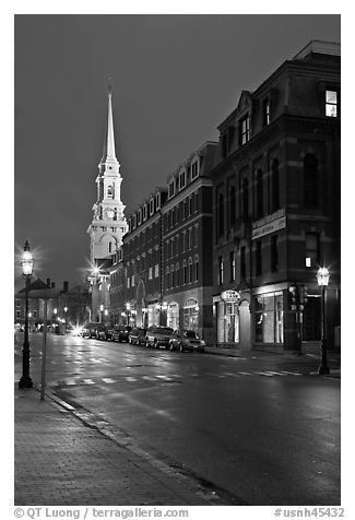 White-steepled Church and street with brick buildings by night. Portsmouth, New Hampshire, USA (black and white)