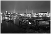 Pier and skyline by night. Portsmouth, New Hampshire, USA (black and white)
