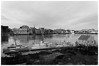 Boats, river, and skyline, early morning. Portsmouth, New Hampshire, USA (black and white)