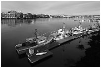Deck, fishing boats, and river. Portsmouth, New Hampshire, USA (black and white)