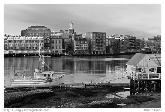 Fishing boat, shack, and waterfront buildings. Portsmouth, New Hampshire, USA (black and white)
