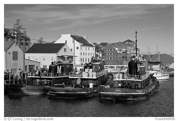 Tugboats and waterfront buildings. Portsmouth, New Hampshire, USA (black and white)