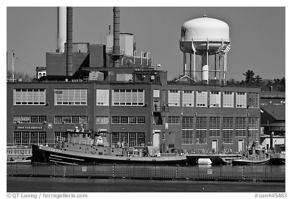Tugboats and brick buildings, Naval Shipyard. Portsmouth, New Hampshire, USA (black and white)