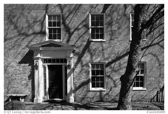 Brick house with tree shadows. Portsmouth, New Hampshire, USA (black and white)