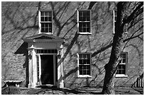 Brick house with tree shadows. Portsmouth, New Hampshire, USA ( black and white)