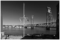 Riverside plaza, flagpole, and memorial bridge. Portsmouth, New Hampshire, USA (black and white)