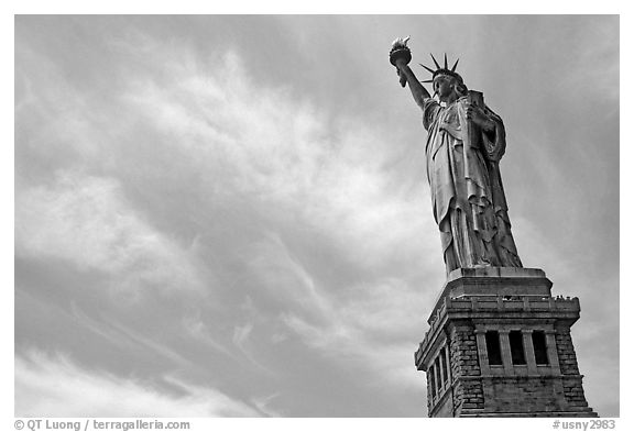 Statue of Liberty and pedestal against sky. NYC, New York, USA (black and white)