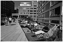 People sunning themselves on the High Line. NYC, New York, USA (black and white)