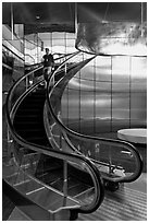 Rare curved escalator, Bloomberg Tower. NYC, New York, USA (black and white)