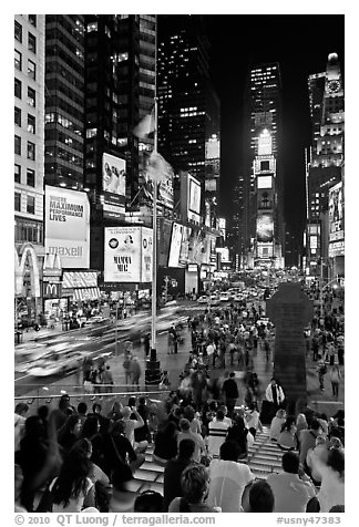 One Times Square at night and Francis Duffy monument. NYC, New York, USA (black and white)