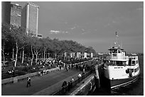 Tour boat along Battery Park, evening. NYC, New York, USA ( black and white)