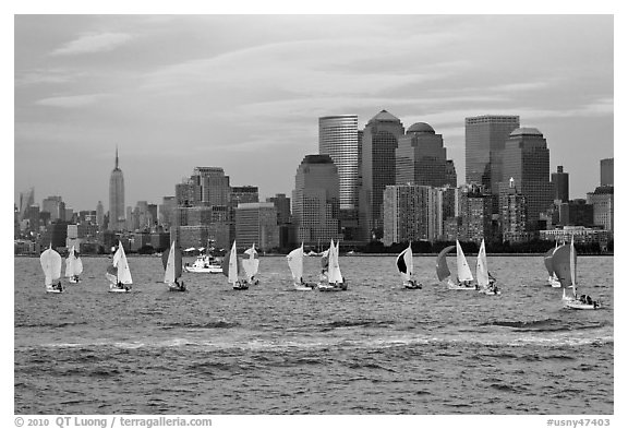 Sailboats, lower and mid Manhattan skyline. NYC, New York, USA (black and white)