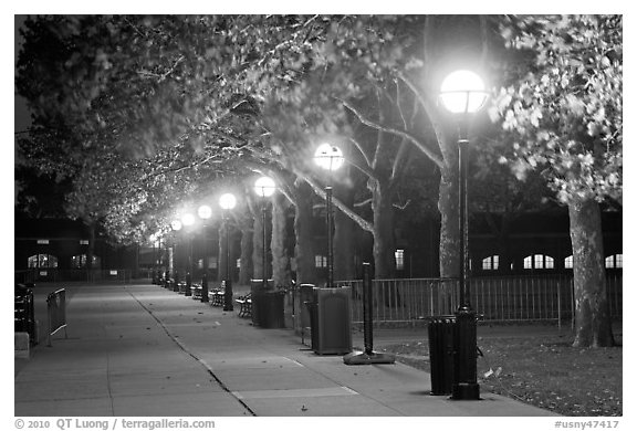 Row of lights by night, Ellis Island. NYC, New York, USA (black and white)