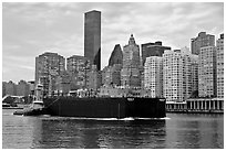 Barge on Hudson River and Manhattan waterfront. NYC, New York, USA ( black and white)