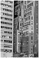 Old high-rise buildings with exterior pipe. NYC, New York, USA ( black and white)