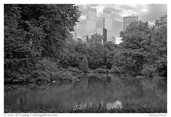 Pond and skyscrappers, Central Park. NYC, New York, USA (black and white)