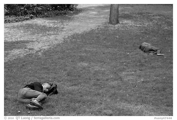 Men sleeping on lawn, Central Park. NYC, New York, USA (black and white)