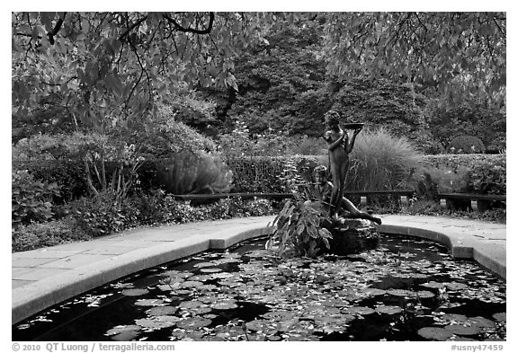 Pool and sculpture inspired by children South Garden. NYC, New York, USA (black and white)