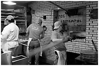Pizza preparation, Lombardi pizzeria kitchen. NYC, New York, USA ( black and white)