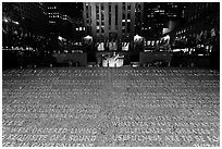 Rockefeller plaza and rink by night with Credo plaque. NYC, New York, USA ( black and white)