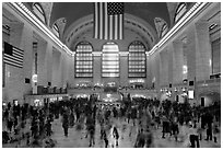 Dense crowds in  main concourse of Grand Central terminal. NYC, New York, USA (black and white)