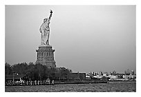 Statue of Liberty and Liberty Island from the back, sunset. NYC, New York, USA ( black and white)
