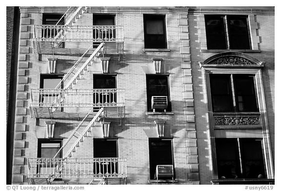 Residential building with emergency exit staircases. NYC, New York, USA (black and white)