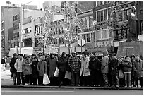 Gathering in Chinatown in winter. NYC, New York, USA ( black and white)