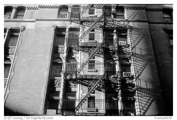 Emergency exit staircases on the side of a building. NYC, New York, USA (black and white)