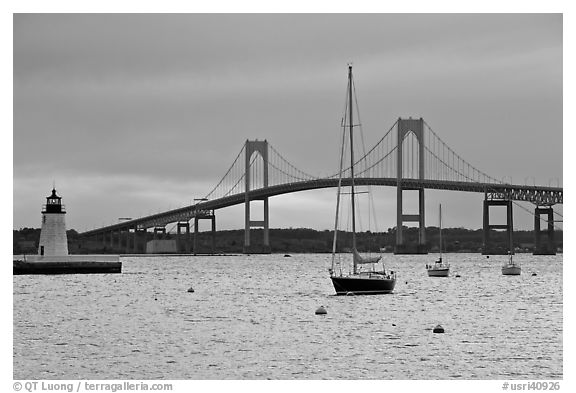 Newport Bridge and Newport Harbor lighthouse at sunset. Newport, Rhode Island, USA (black and white)