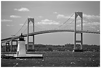 Newport Harbor lighthouse, Newport Bridge, and Narragansett Bay. Newport, Rhode Island, USA (black and white)