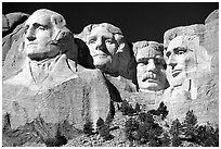 Faces of Four US Presidents carved in cliff, Mt Rushmore National Memorial. South Dakota, USA (black and white)