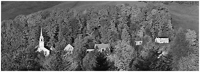 White-steppled church and houses amongst trees in fall foliage. Vermont, New England, USA (Panoramic black and white)