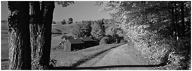 Pastoral view with road and farm in autumn. Vermont, New England, USA (Panoramic black and white)