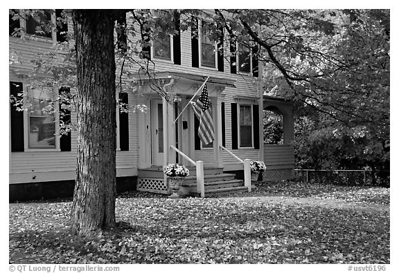 House with American flag and red leaves. Vermont, New England, USA (black and white)