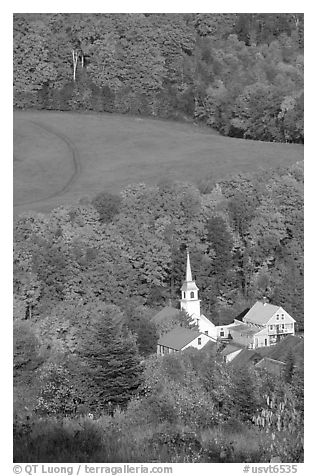 Church of East Corinth among trees in fall color. Vermont, New England, USA (black and white)