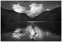 Thunderstorm clouds at sunrise reflected in reservoir. Hells Canyon National Recreation Area, Idaho and Oregon, USA ( black and white)