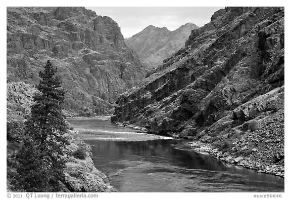 High cliffs above free-flowing part of Snake River. Hells Canyon National Recreation Area, Idaho and Oregon, USA (black and white)