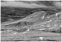 Painted hills and fog, winter dusk. John Day Fossils Bed National Monument, Oregon, USA ( black and white)