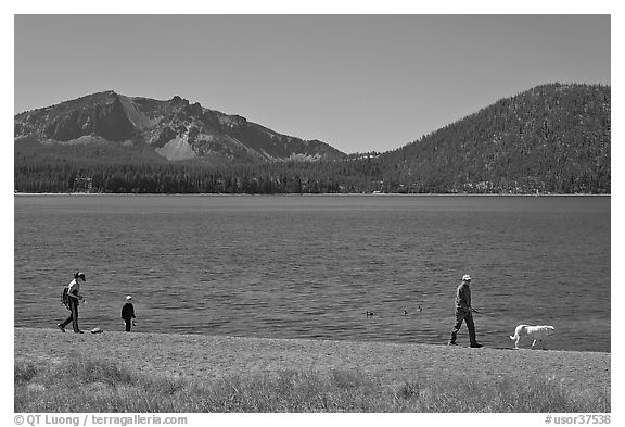 Family strolling on shore of East Lake. Newberry Volcanic National Monument, Oregon, USA (black and white)