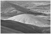 Bare ash mounds and sagebrush-covered slopes. John Day Fossils Bed National Monument, Oregon, USA ( black and white)