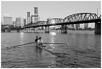 Men on double-oar shell rowing on Williamette River. Portland, Oregon, USA ( black and white)