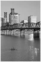 Double-oar rowboat and  Hawthorne Bridge. Portland, Oregon, USA (black and white)