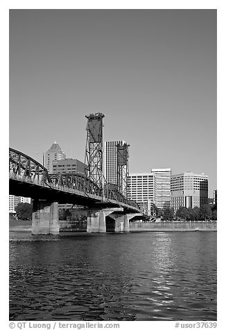 Williamette River at Hawthorne Bridge and high-rise buildings. Portland, Oregon, USA (black and white)