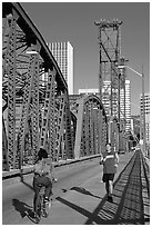 Jogger and cyclist on Hawthorne Bridge. Portland, Oregon, USA (black and white)