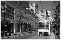 Street with tram, downtown. Portland, Oregon, USA ( black and white)