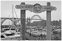 Newport marina and sign, foggy sunrise. Newport, Oregon, USA (black and white)