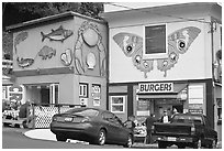 Seafood and burger restaurants. Newport, Oregon, USA (black and white)